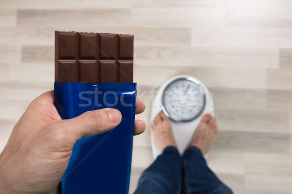 Person Holding Chocolate Measuring Weight Stock photo © AndreyPopov