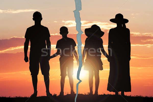 треснувший фото семьи закат силуэта трещина Сток-фото © AndreyPopov