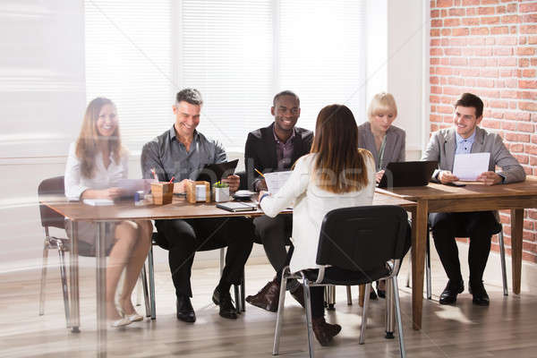 Group Of Businesspeople In The Office Stock photo © AndreyPopov