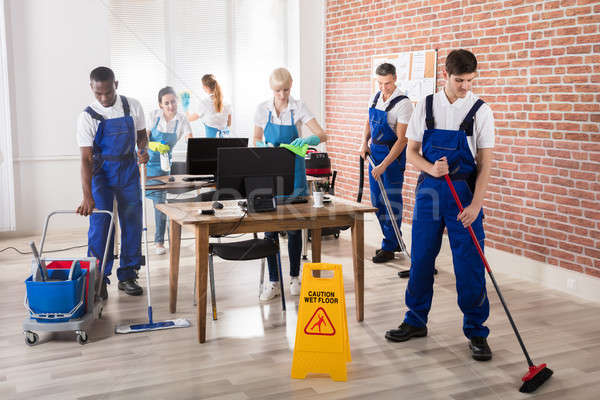 Janitors Cleaning The Office Stock photo © AndreyPopov