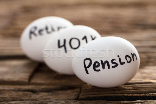 Pension  401K And Retire Written On White Eggs Stock photo © AndreyPopov