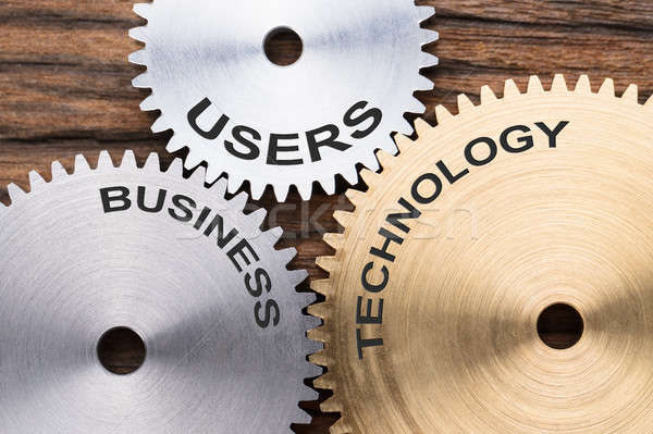 Closeup Of Users  Business And Technology Interlocked Cogwheels Stock photo © AndreyPopov