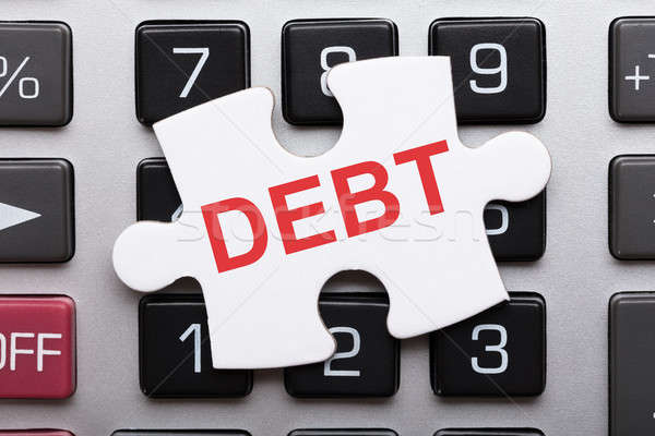 Jigsaw Puzzle Piece With Debt Text On Calculator Stock photo © AndreyPopov