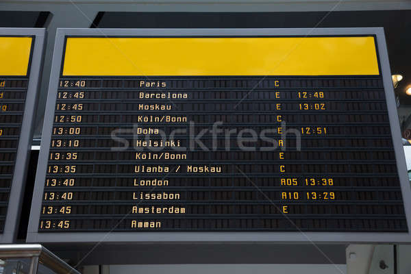 Flight information board in airport Stock photo © AndreyPopov