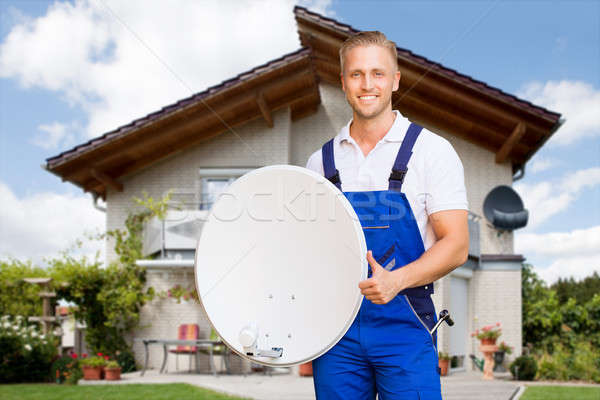 Man Holding Satellite Dish Showing Thumb Up Sign Stock photo © AndreyPopov