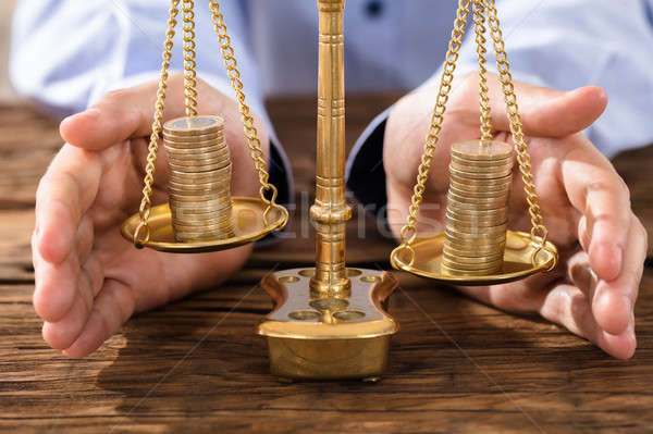 Person Protecting Justice Scale With Coins Stock photo © AndreyPopov