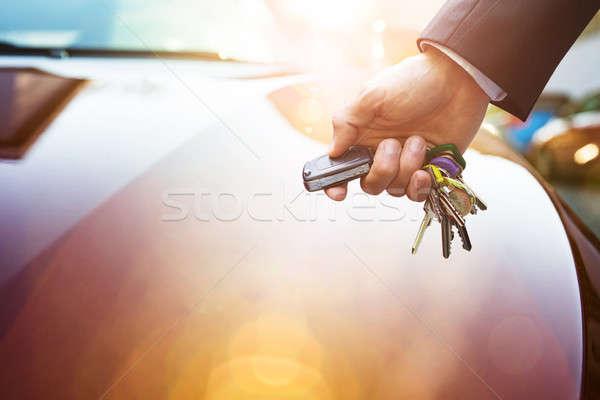Man's Hand Holding Remote Control Car Keys Stock photo © AndreyPopov