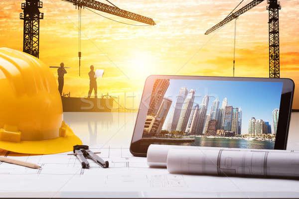 Digital Tablet And Hardhat On Blueprint Stock photo © AndreyPopov