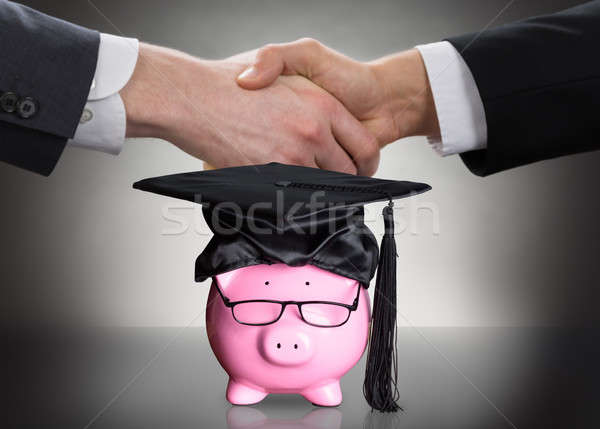 Piggy Bank With Black Graduation Hat And Eyeglasses Stock photo © AndreyPopov