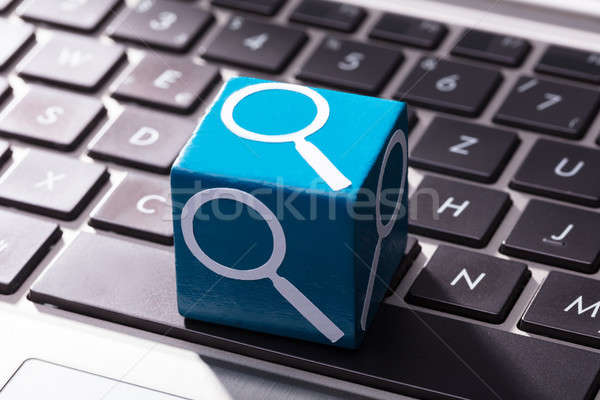 Magnifying Glass Symbol Block Over The Laptop Keypad Stock photo © AndreyPopov