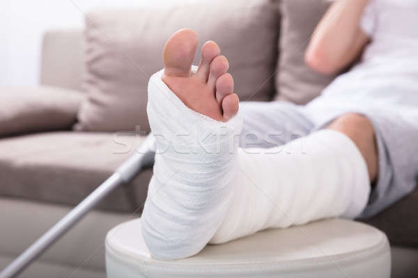 Сток-фото: ногу · фото · дома · человека · таблице