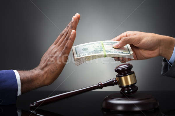 Close-up Of A Judge's Hand Refusing Bribe Stock photo © AndreyPopov