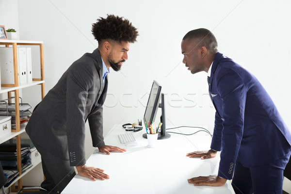 Two Businessmen Shouting At Each Other Stock photo © AndreyPopov