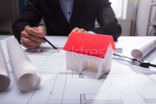Close-up Of House Model On Blueprint Stock photo © AndreyPopov