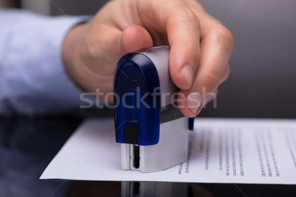Businessperson Stamping Document Stock photo © AndreyPopov