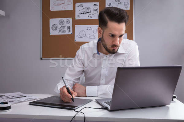Male Designer Using Graphic Tablet Stock photo © AndreyPopov