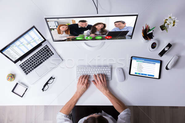 Businessperson Video Conferencing On Computer Stock photo © AndreyPopov
