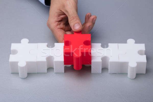 Személy piros kirakós játék személyek kéz darab Stock fotó © AndreyPopov