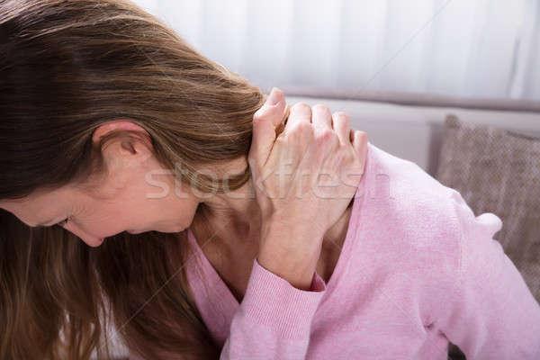 成熟した女性 腰痛 クローズアップ 女性 ホーム ストックフォト © AndreyPopov