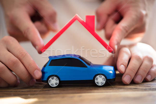 Human Hand Protecting Blue Car Stock photo © AndreyPopov