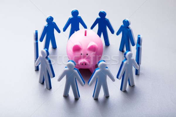 Human Figures Surrounding Pink Piggybank Stock photo © AndreyPopov
