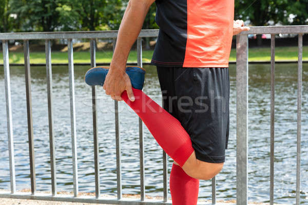 Male Runner Stretching His Leg Stock photo © AndreyPopov