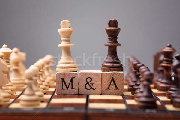 King Chess Pieces With Mergers And Acquisitions Text Stock photo © AndreyPopov
