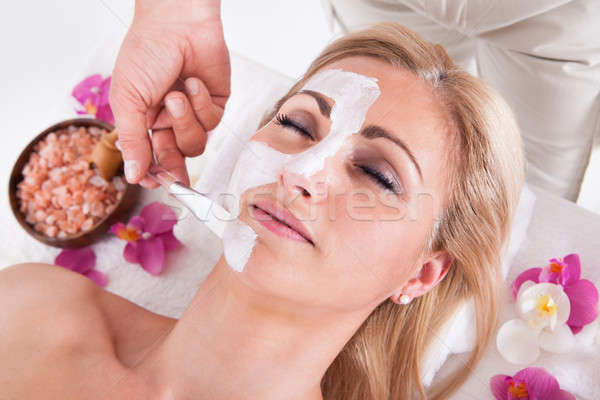 Stock photo: Cosmetician Applying Facial Mask On Face Of Woman