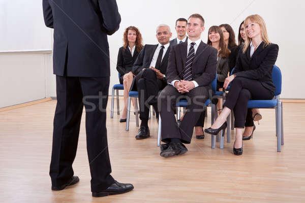 Grup iş adamları kadın gülümseme toplantı çalışmak Stok fotoğraf © AndreyPopov