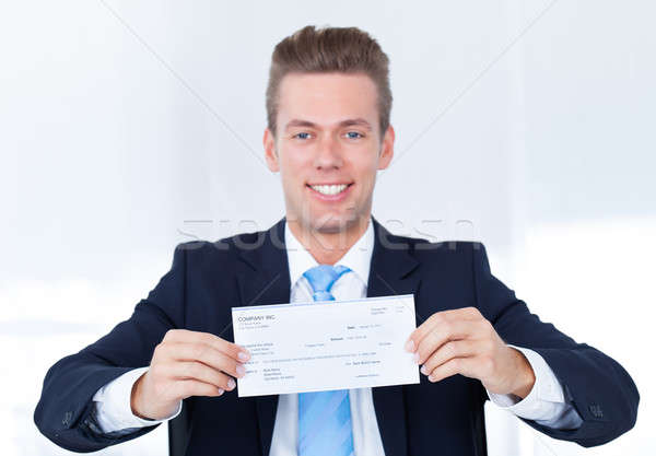 Zakenman cheque portret jonge gelukkig Stockfoto © AndreyPopov