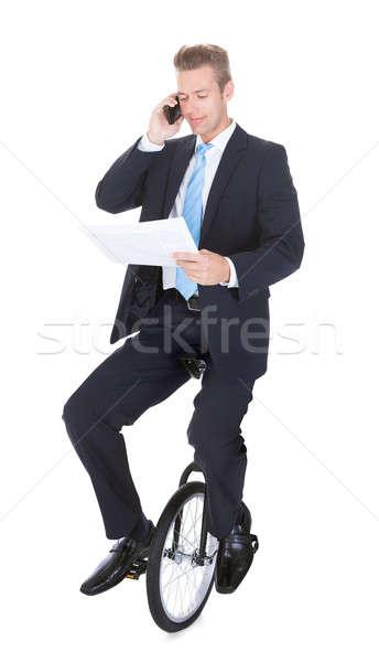 ビジネスマン 座って 一輪車 話し 携帯電話 白 ストックフォト © AndreyPopov