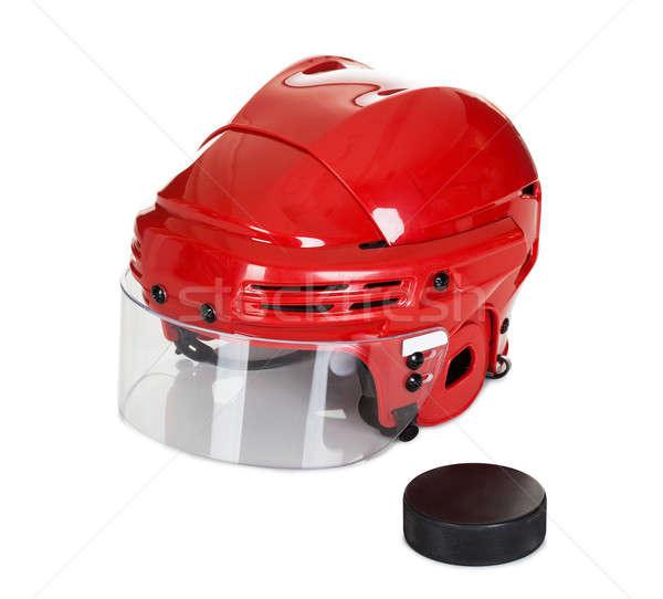 Stock photo: Hockey helmet and puck