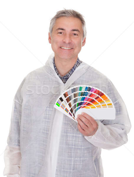 Mature Man With Protective Workwear Holding Color Swatch Stock photo © AndreyPopov