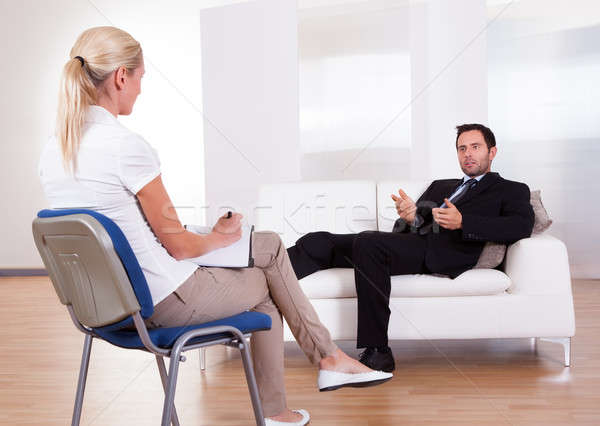 Uomo parlando psichiatra spalla view uomo d'affari Foto d'archivio © AndreyPopov