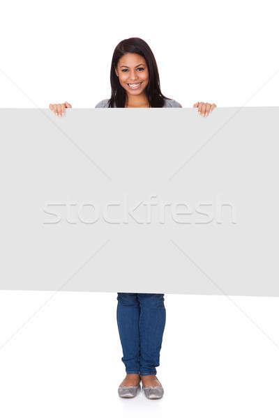 Fiatal nő tart plakát izolált fehér üzlet Stock fotó © AndreyPopov