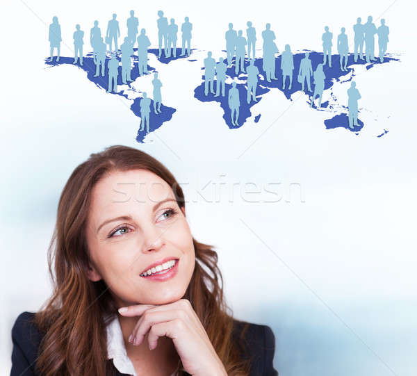 Businesswoman With Human Icons On World Map Stock photo © AndreyPopov