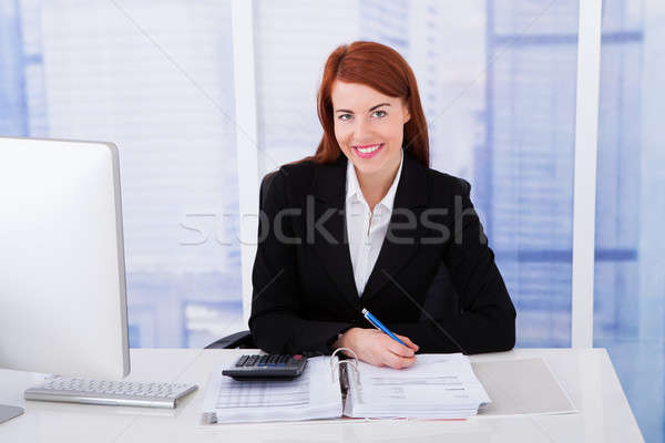 Confident Businesswoman Calculating Tax Stock photo © AndreyPopov