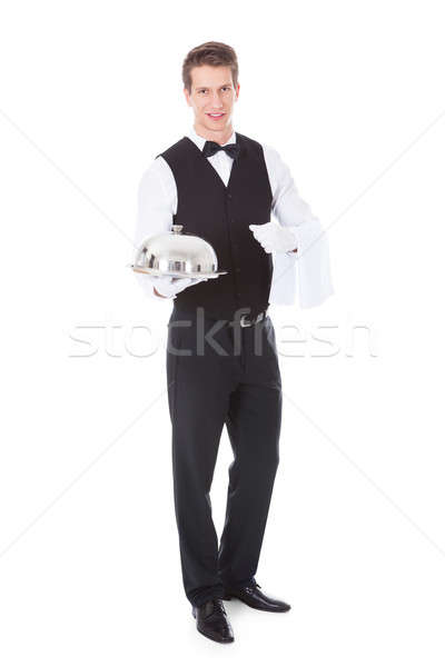 Waiter Holding Cloche Lid Cover Stock photo © AndreyPopov
