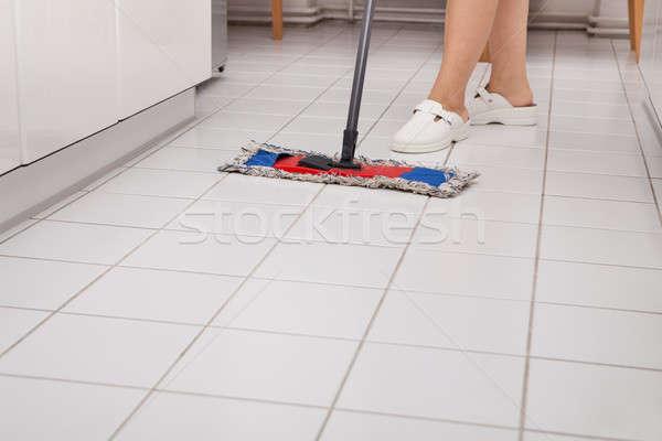 Fiatal szobalány takarítás konyha padló közelkép Stock fotó © AndreyPopov