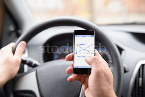 Man Using Cellphone While Driving Stock photo © AndreyPopov