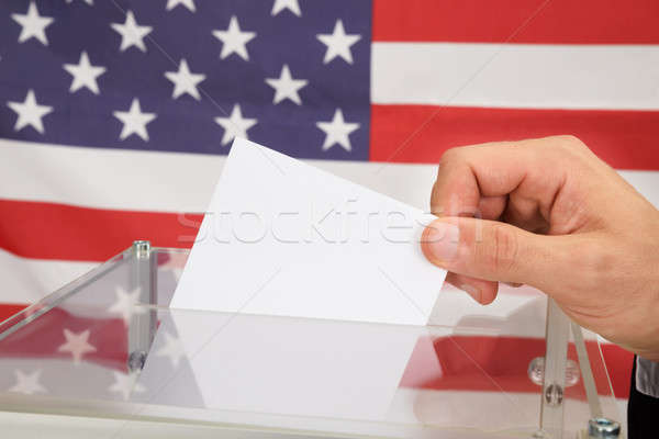 Person Casting A Ballot In Front Of Usa Flag Stock photo © AndreyPopov