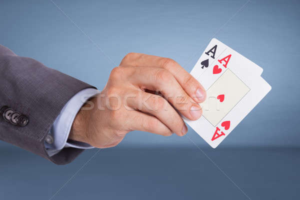 Stock photo: Hand holding aces cards