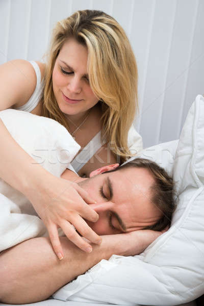 Woman Is Holding Husband's Nose Stock photo © AndreyPopov