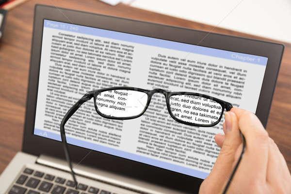 Persona mano occhiali laptop primo piano Foto d'archivio © AndreyPopov