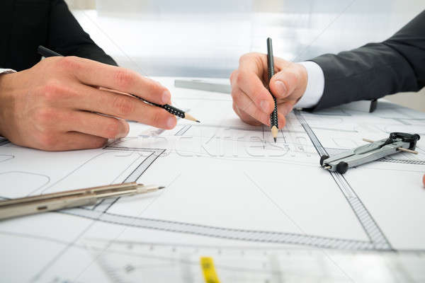 Close-up Of Two Architects Working On Blueprint Stock photo © AndreyPopov