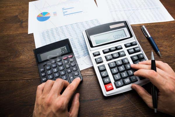 üzletember pénzügyi grafikon üzlet papír férfi Stock fotó © AndreyPopov