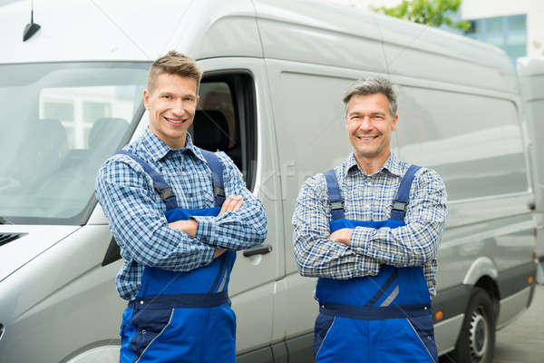 Two Repairmen With Arms Crossed In Front Of Van Stock photo © AndreyPopov