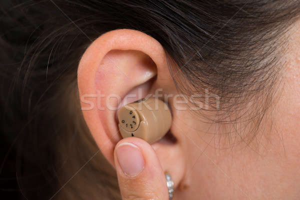 Woman Ear With Hearing Aid Stock photo © AndreyPopov