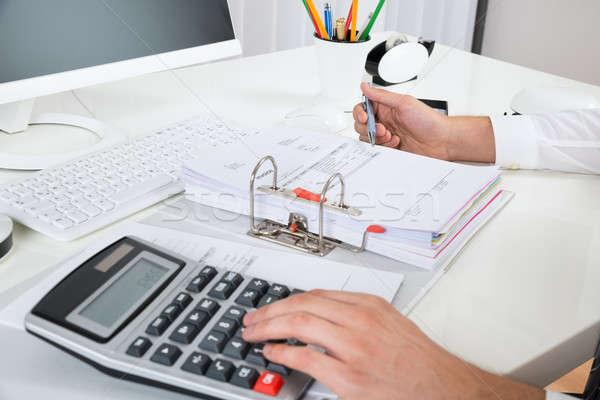 üzletember költségvetés asztal közelkép számológép iroda Stock fotó © AndreyPopov