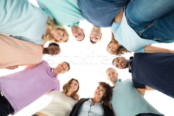 Retrato criador pessoas de negócios em pé diretamente abaixo Foto stock © AndreyPopov